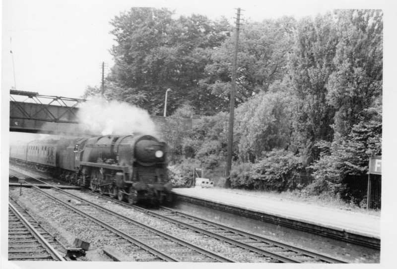 Fleet, Hampshire sees BoB 34077 603 Squadron arriving with a Waterloo stopping service on 05/06/65 - the Eastleigh loco being withdrawn in March 67.