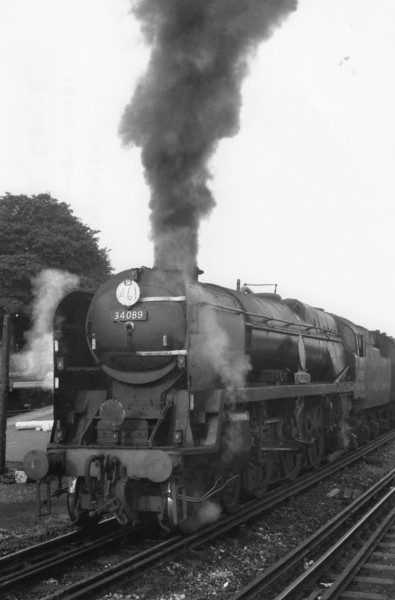 The 18 00 Waterloo to Salisbury departs Basingstoke on 27/07/66 with Salisbury's clean 34089 602 Squadron.