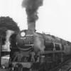 The 18 00 Waterloo to Salisbury departs Basingstoke on 27/07/66 with Salisbury's clean 34089 602 Squadron.