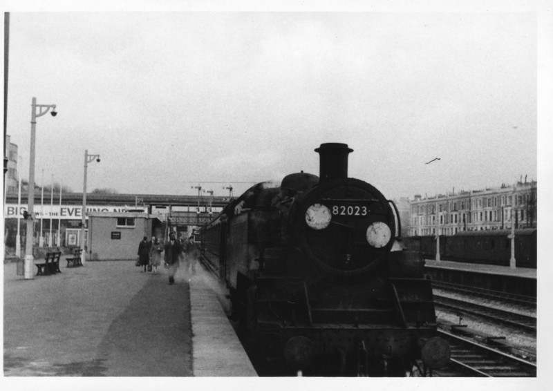 The GPO offices at Kensington were in the habit of taking a half day on the day preceding a bank holiday and this was the case on 03/05/66 when Nine Elms BR 3MT 82023 was seen working the 12 36 to Clapham Junction.