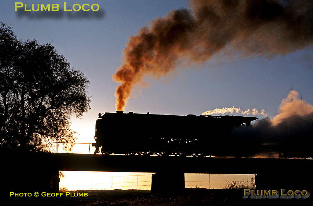 Silhouetted against the setting sun, SAR Class 23 4-8-2 No. 3273 is at the head of the evening SX mixed train No. 21, the 17:12 from Bloemfontein to Springfontein (arrival time 22:10) on the line to Noupoort, Tuesday 5th September 1972. Slide No. 10111.