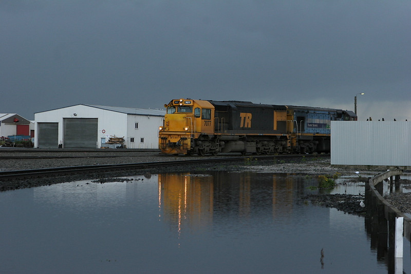 At Invercargill, a stormy sky threatens as a train prepares to leave for Dunedin.
