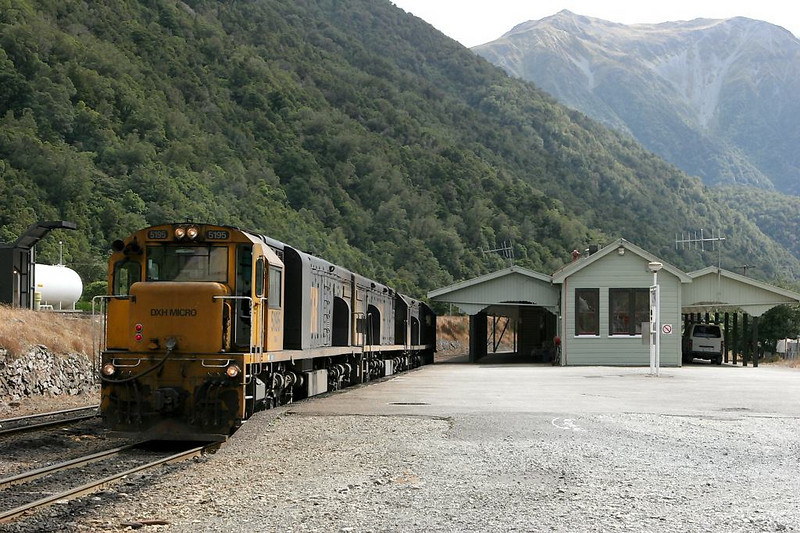 The crown jewel of South Island railroading - Otira at the base of Arthur's Pass. Here, a three-engine helper set waits for an eastbound loaded coal train.