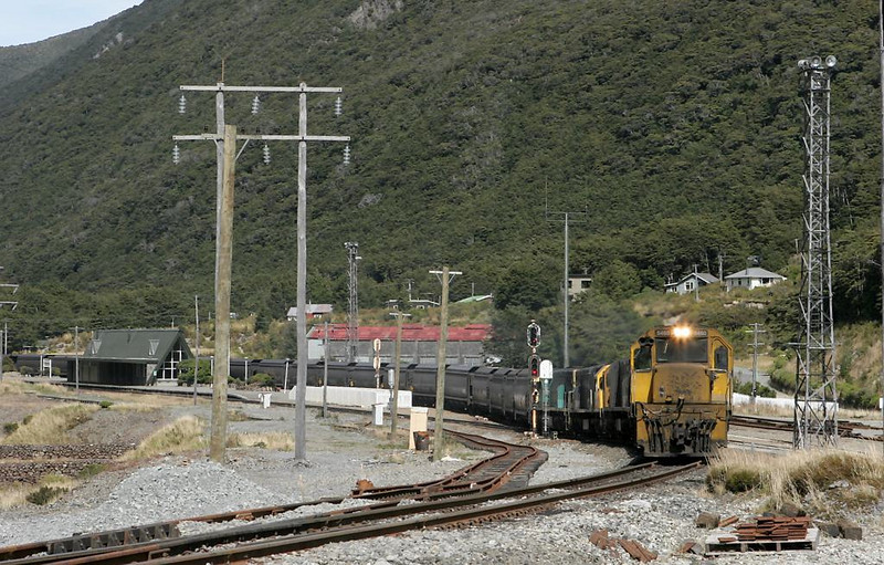 The helpers have coupled on to a westbound empty move for the run back to Otira.