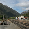 A view up the pass. At right in the distance, the old electric motor barn can be seen. A small spot in the middle of nowhere, Otira even boasts a pedestrian underpass.
