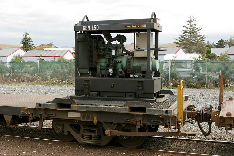 New Zealand's railroads are full of interesting details. This portable generator supplies electric power to refrigerated containers. The huge handbrake lever on the car is decidedly British in appearance.