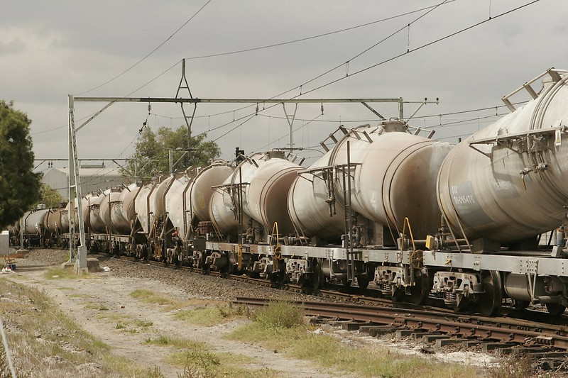 "A freight train leaving the yard eastbound has this exotic array of ""extreme funnel flow"" tank cars in its consist."