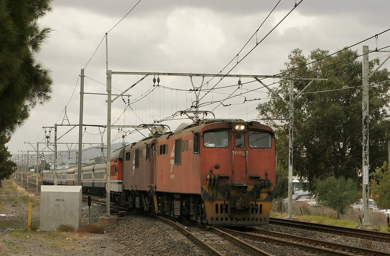 "The day at Stikland begins with an inbound passenger train crossing over to the ""wrong"" main for the final leg of the trip into Cape Town."