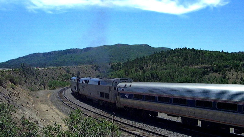 Following a mysterious stop of about 15 minutes a mile or so short of the summit, Southwest Chief train 3 slowly gets underway to continue its arduous climb up through Raton Pass, 8-13-11.