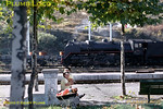 Two local kids play with their toys at Alsasua station in the foothills of the Pyrenees, oblivious to the RENFE 141F 2-8-2 simmering in the background at the head of a freight train waiting to take the line to Pamplona. Saturday 31st October 1970. Slide No. 5571.