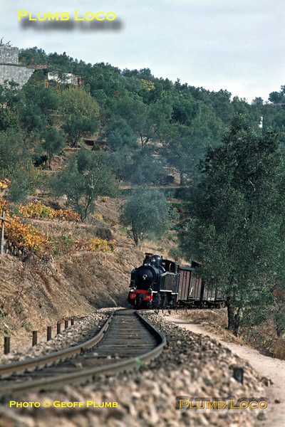Mallet No. E208 climbs its way around the curves between Carrazedo and Cruzeiro with the 12:30 train from Régua to Chaves, due to arrive in Vila Real at 13:53. Wednesday 4th November 1970. Slide No. 5776.