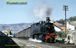 Immaculate CP Mallet 2-4-6-0T No. E214 departs from Régua along the mixed-gauge main line to Corgo where it will turn north with its mixed train, the 12:30 to Chaves on a beautiful Autumn day, Tuesday 3rd November 1970. Slide No. 5714.