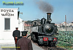 Station staff and engine crew exchange glances as one of the delightful Henschel Mallet 0-4-4-0Ts, No. E164, arrives at the through platform at Povoa de Varzim station with a train from Lousado and Familição, which connected with the train about to be hauled by E142 to Porto Trindade on the metre gauge lines. Monday 3rd November 1969. Slide No. 4352.