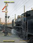 CP 4-6-0 No. 295 departs from Porto Campanhã with a stopping passenger train to Braga on the evening of Sunday 8th November 1970. Alongside is an EMU of stainless steel stock and in the background is an electric loco. Slide No. 5960.