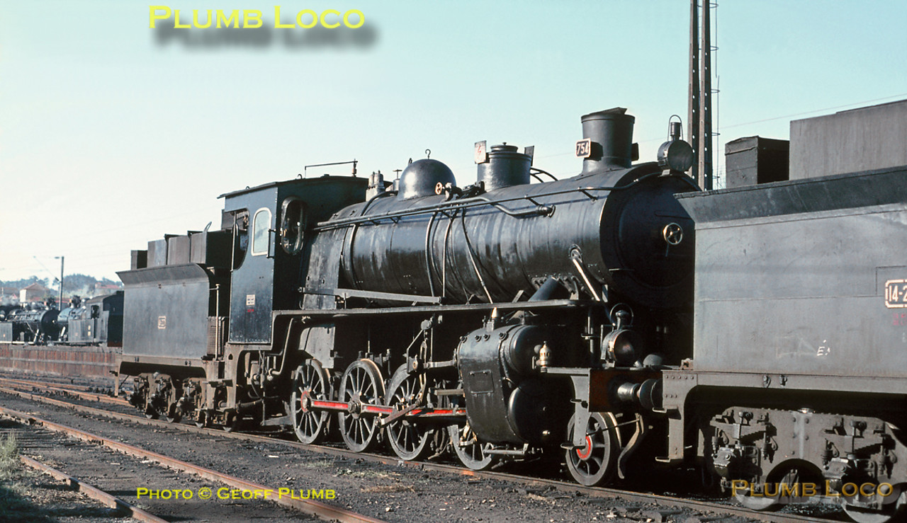 CP 4 cylinder compound 2-8-0 No. 754 was the last working survivor of the class built by Schwartzkopff between 1913 to 1925 (Works No. 5239 of 1914), here resting between duties on shed at Contumil depot on Sunday 8th November 1970. It is now preserved at Entroncamento. Slide No. 5922.