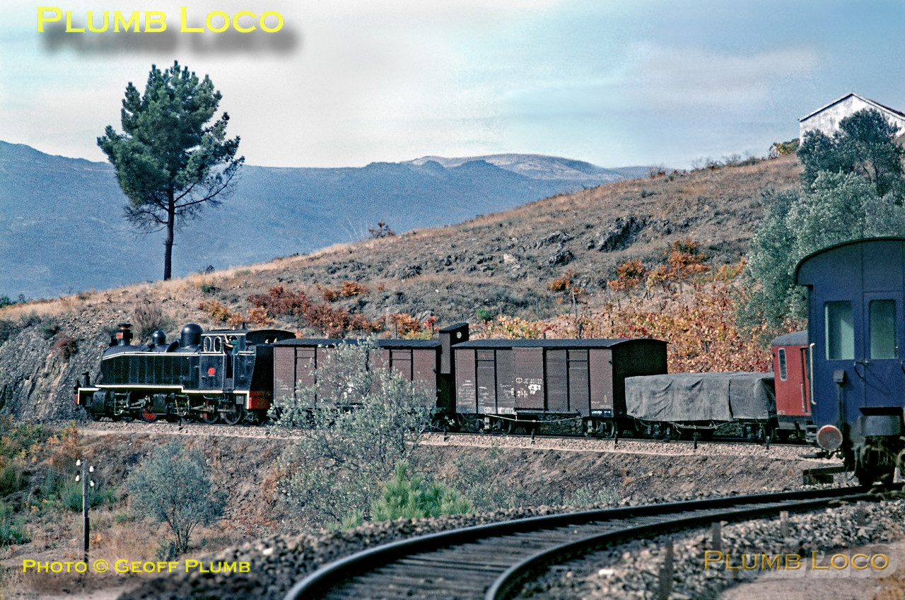 Henschel Mallet 2-4-6-0T No. E208 is working a mixed train towards Vila Real (due to arrive there at 13:53) near Cruzeiro, having worked up the very torturous bends from Carrazedo, the train originating at Régua. It's easy to see why Mallets were a good idea on this line! Wednesday 4th November 1970. Slide No. 5778.