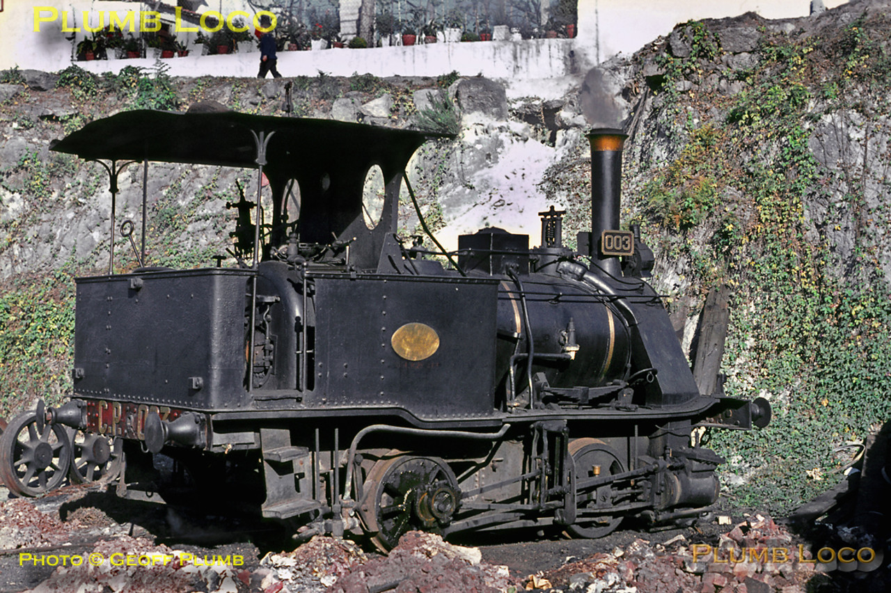 """One of the most famous engines in Portugal was the shed pilot at Contumil depot in Porto, the diminutive 0-4-0WT """"Little Mouse"""" No. 003, built by Cockerill in 1890. Here it is, simmering in the sunshine on Sunday 8th November 1970. Slide No. 5927."""