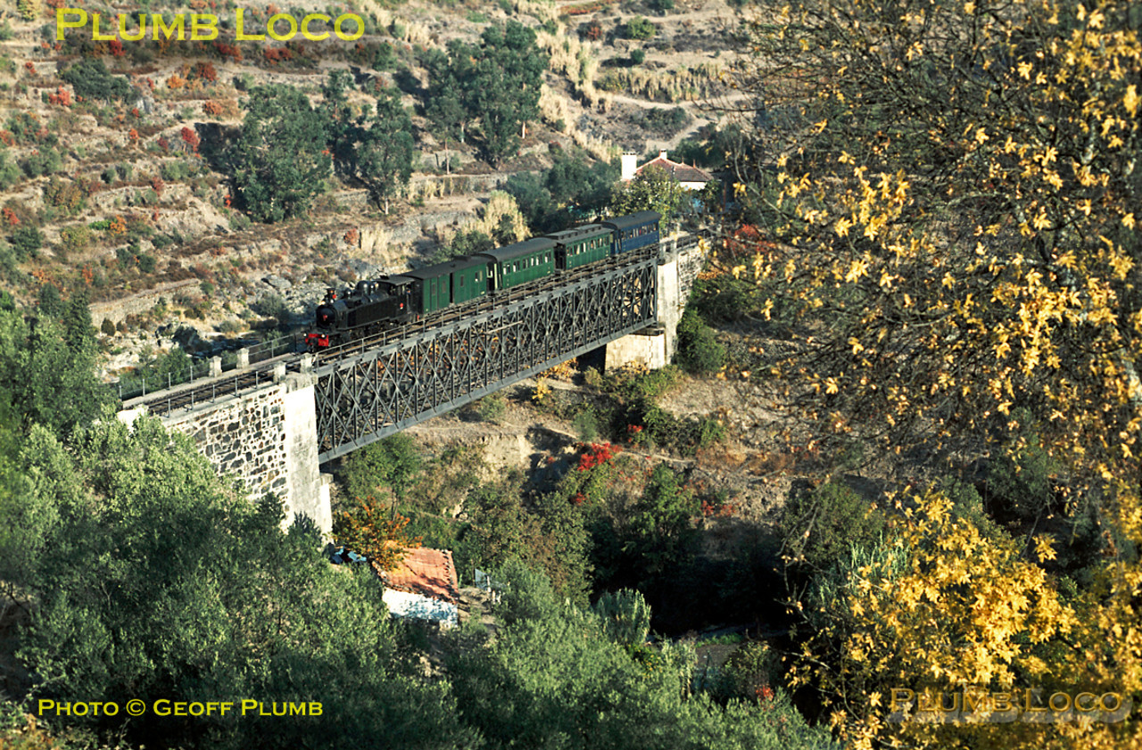 Mallet tank No. E214 crosses the river viaduct over a tributary of the Corgo as it approaches Tanha station with its train from Chaves to Régua, where it was due to arrive at 10:11. Wednesday 4th November 1970. Slide No. 5747.