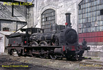 "From the Geoff Plumb Collection of original slides. Former Minho & Douro 2-4-0, CP No. 9, was previously named ""Vila Real"" and was built by Beyer, Peacock (No. 1471 of 1875). This was the last in service of a batch of ten locos and is standing in the shed yard at Porto Campanhã on Saturday 9th May 1964. The loco was preserved and housed for a while in the old loco shed in Braga, where I saw it in 1969. Photo by John F. Robinson. Collect Slide No. JFR31."