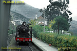 Seen from the diesel unit in which I was travelling from Régua to Pocinho, 4-6-0 No. 292 is waiting with another Porto bound train at Covelinhas station, one of many beautifully kept stations on the Douro valley line. Saturday 7th November 1970. Slide No. 5874.
