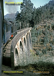 View from the 14:10 train from Sernada do Vouga to Viseu as Henschel Mallet 2-4-6-0T No. E213 crosses the viaduct (Poço de S. Tiago) on the line between Sernada and Paradela as the line follows the valley of the Rio Vouga. Tuesday 10th November 1970. Slide No. 6014.