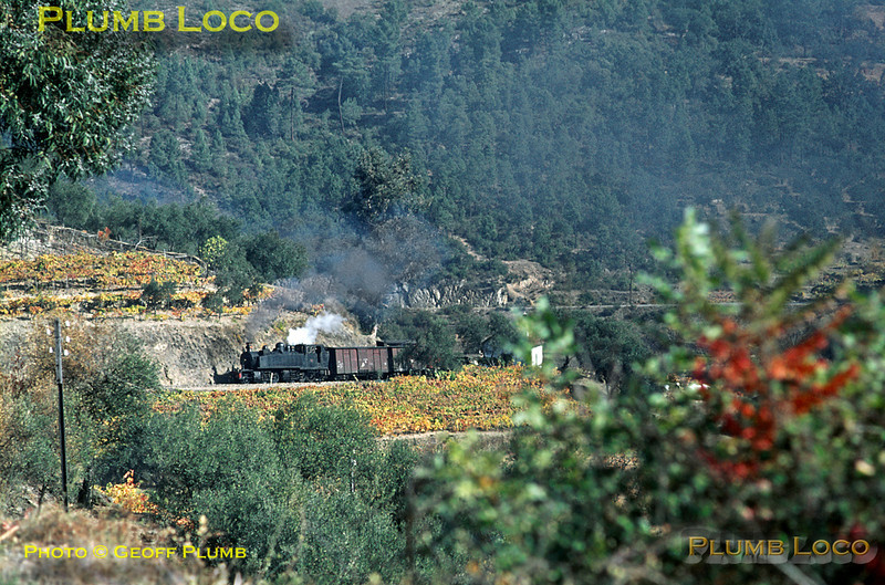 "After a good ""brew-up"" at Carrazedo station, E207 is now climbing round the multitude of curves as it climbs up towards Cruzeiro with its mixed train from Régua to Chaves, due to arrive at Vila Real at 13:15. Thursday 5th November 1970. Slide No. 5813."