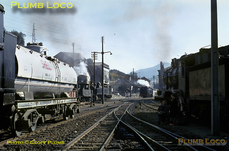 Régua station is a hive of activity as 2-6-4T No. 076 shunts a Shell Oil tank wagon on the left while 4-6-0 No. 286 is waiting on the right to take out the train from Porto to Barca d'Alva at 12:35, once the shunting has finished. In the background is metre-gauge shunter 0-6-0T No. E54 and two Henschel 2-4-6-0T Mallets, Nos. E212 and E214 which will take the 12:30 departure for Chaves on the Corgo line. Tuesday 3rd November 1970. Slide No. 5713.