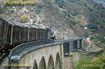 Aboard the 12:32 departure from Pocinho, a mixed train from Barca d'Alva to Porto, the view from the train as 4-6-0 No. 286 climbs away from Pocinho and crosses a viaduct over a tributary river as it heads into the Douro gorge. Saturday 7th November 1970. Slide No. 5899.
