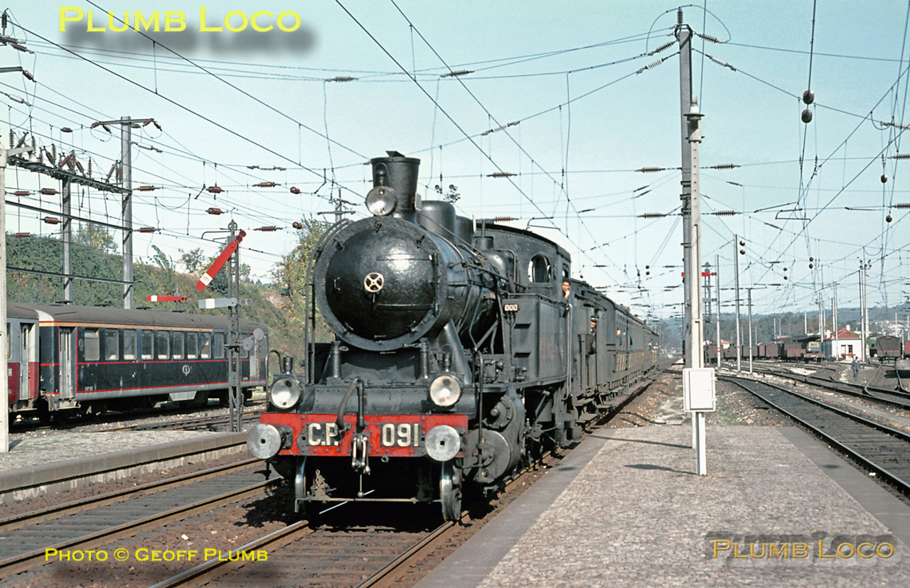 Gleaming CP 2-6-4T No. 091 drifts into Contumil station with a train of ancient passenger coaches, the 11:15 from Régua to Porto Campanhã on Sunday 8th November 1970. Despite the electrification, some interesting semaphore signals are still in use. No. 091 was one of the engines built by Henschel in 1929. Slide No. 5953.