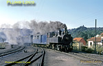 Metre gauge Henschel Mallet 0-4-4-0T No. E151 arrives at Sernada do Vouga at 14:05 with a train from Aveiro. It came off the train here and was replaced by 2-4-6-0T No. E213 to depart for Viseu at 14:10. Tuesday 10th November 1970. No. E151 (built 1905) was based at Livração on the Tamega line for many years, but arrived on the Sernada system in November 1969. Slide No. 6007.