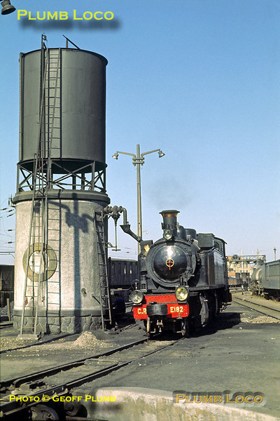 Mallet No. E182 now replenishes its tanks from the imposing water tower at the metre gauge depot at Espinho, Monday 9th November 1970. Slide No. 5973.