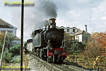 Mallet tank No. E207 has taken water at Vila Real and now sets off from the station for the rest of its journey to Chaves, with the 10:21 train from Régua. The line is still open from Régua to Vila Real, sadly, the remainder of the line has been abandoned. Wednesday 4th November 1970. Slide No. 5770.