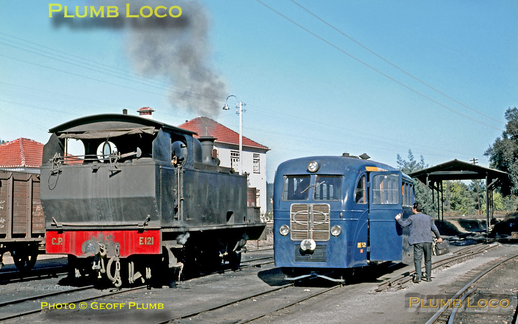 """The crew of a """"Railbus"""", No. ME 52, leave it alongside Borsig 4-6-0T No. E121, after it had arrived with a morning working from Viseu to Santa Comba Dão, on the track leading to the rudimentary loco shed. The metre gauge station here was alongside the broad gauge station on the line from Pampilhosa to Vila Formosa. Wednesday 11th November 1970. Slide No. 6040."""