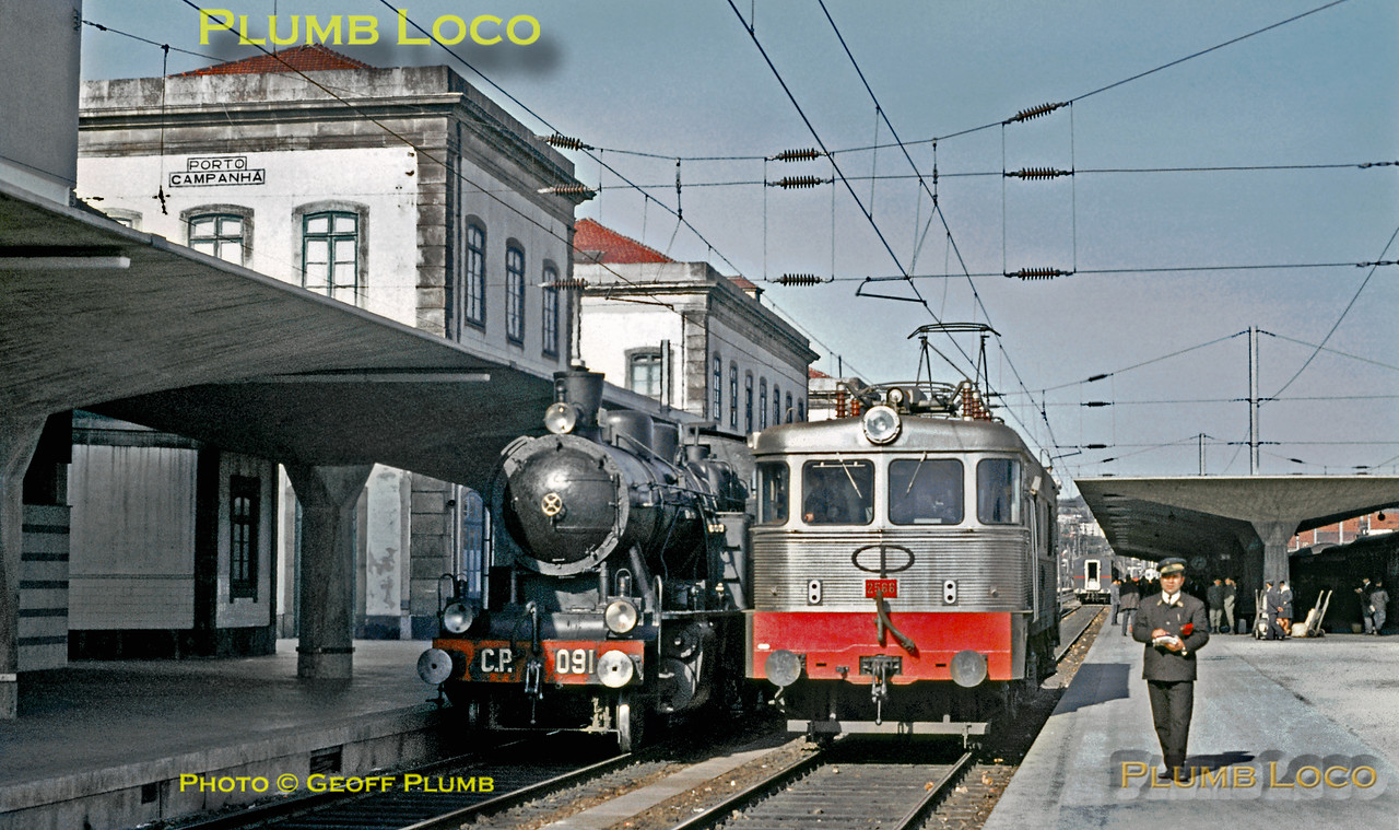 Henschel 2-6-4T No. 091 poses alongside electric loco No. 2566 at Porto Campanhã Station. The steam engine had just arrived with the 11:15 train from Régua and was about to return to the loco depot at Contumil, while the electric took over the train to continue the journey south on the main line. Sunday 8th November 1970. No. 2566 is Class 2550, built by Groupement 50Hz in 1963-64. Slide No. 5954.
