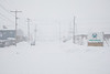 Downtown Moosonee seen from train station during heavy snowfall.
