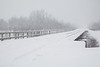 Railway bridge across Store Creek in Moosonee during heavy snowfall.
