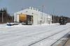 Diesel shed at Moosonee Ontario Northland Railway station. Boxcar 7795, tank car GATX 5037, flatcar.