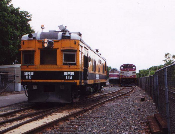 SRS 118 waits for a train to pass in the Franklin Layover.