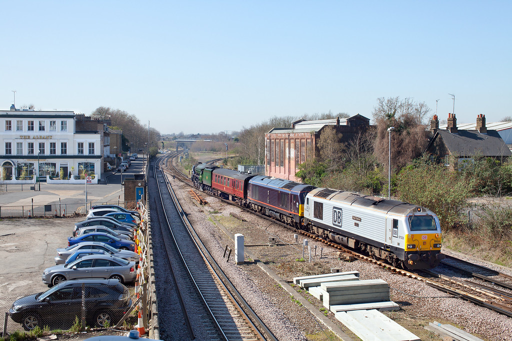 "67029 and 67005 pass Twickenham Junction pulling 60163 ""Tornado' and one support coach on the 5Z04 11.09 Wimbledon Park CSD to Southall Loco Services. 26.3.12"