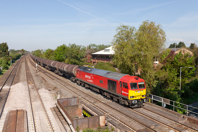 On one of the few sunny mornings this spring, 60007 'The spirit of Tom Kendall' approaches Langley with the Su 6A70 08.32 Didcot TC-Colnbrook Elf Oil sidings loaded oil train.