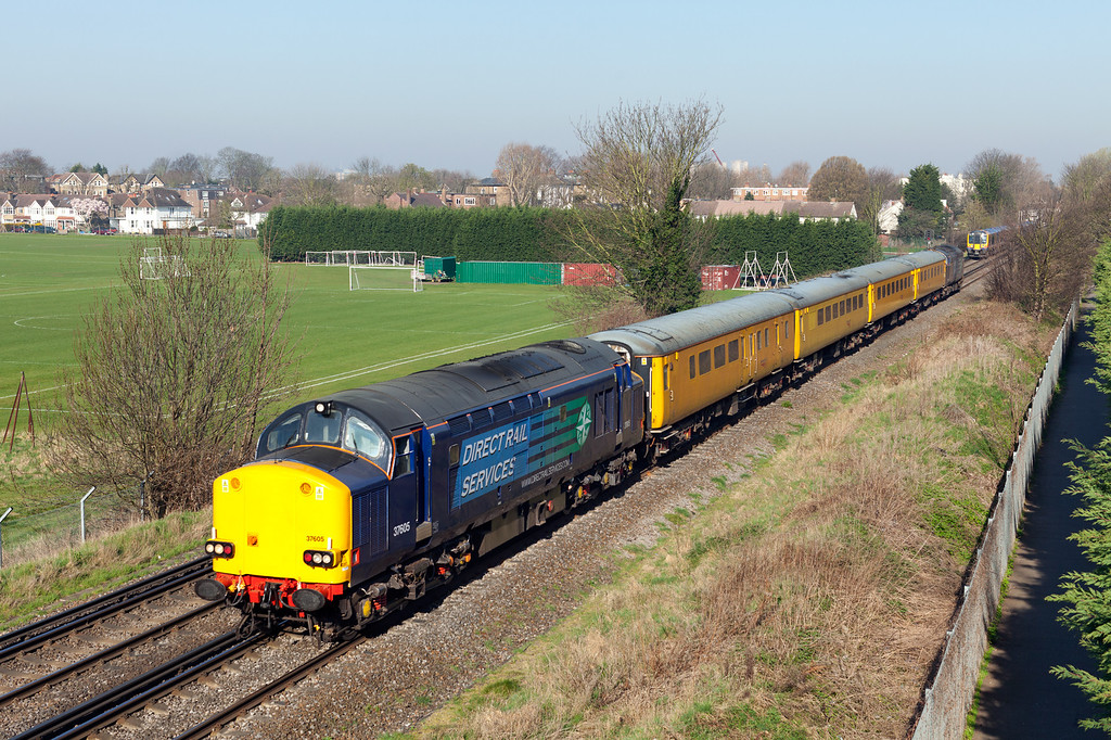 On a stunning March morning 37605 makes a welcome return to the southern region as it approaches the A316 road bridge at Chiswich with the 1Q14 06.32 Derby RTC-Grove Park down reception siding Network Rail measurement train. 26.3.12