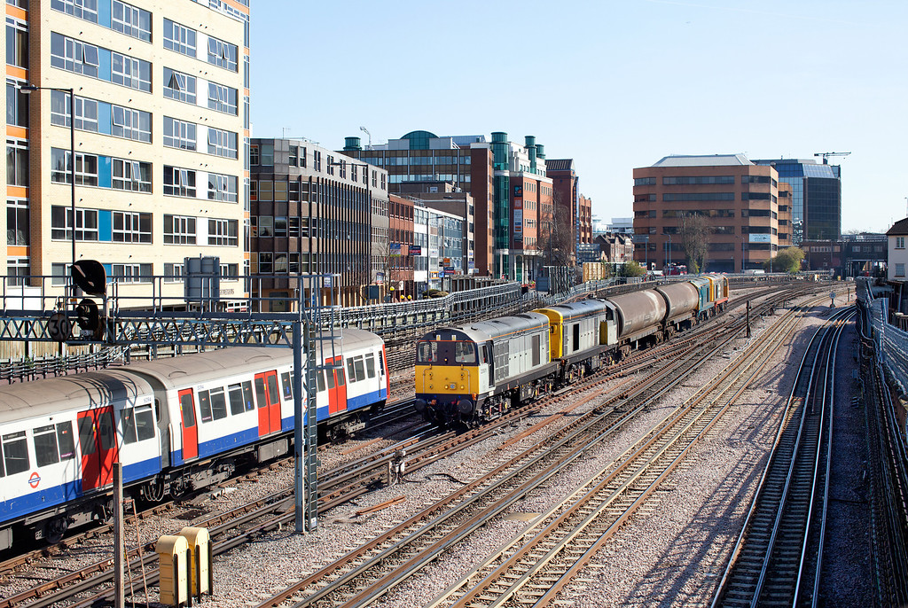 The wonderful sound of 'choppers' on the 'Met'. 20901 and 20905 leave Harrow-on-the-Hill with train 747, the 11.13 Neasden Depot-Ruislip Barrier move. 20142 and 20227 make up the rear of this working. 27.3.12