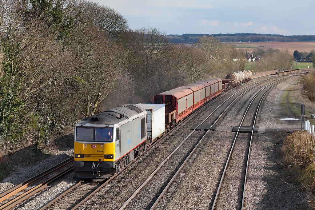 Celebrity loco, interesting train. 60099 has just crossed Molesford viaduct on the approach to Cholsey with the 6V38 11.01 Marchwood-Didcot yard wagonload train.14.3.13
