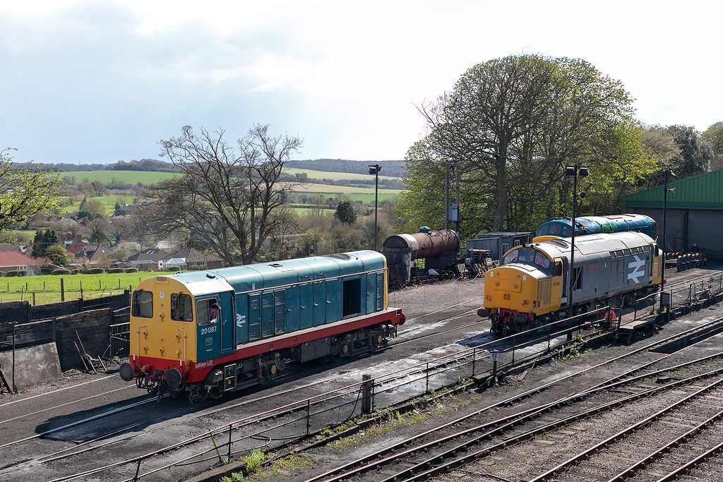 It could almost be the 1980's, a timeless and delightful scene taken at Ropley during the excellent 2013 Mid Hants Diesel Gala. <br /> 20087 shunts into the yard while 37901 waits it's next duty and 45132 sits under repair in the background. 26.4.13