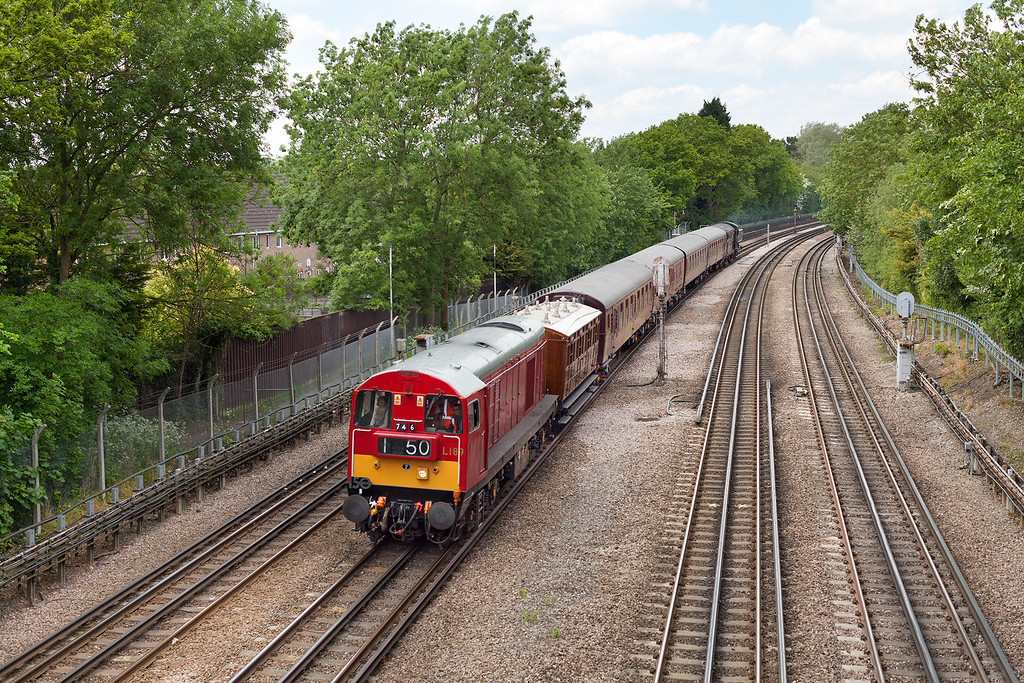 On Monday spring bank holiday, 20189 passes through Northwood with a special to celebrate the 150th anniversary of the opening of the London Underground. Here train 746 formed of 20189, coach 353, 4TC unit, Sarah Siddons and steam locomotive 9466 head south with the 12.08 Amersham- Harrow-on-the-hill service.