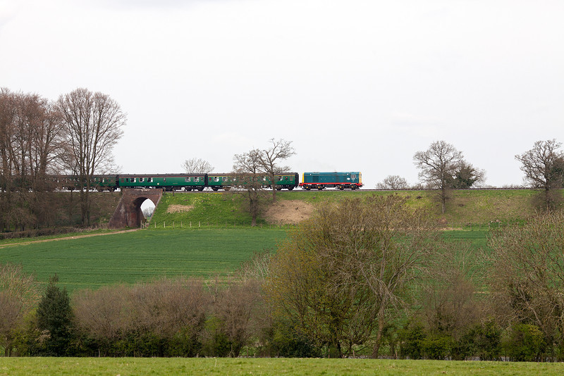 Wonderful location and train, shame about the weather. 20087 pulls a morning Alresford-Alton service towards Medstead during the 2013 Mid Hants Diesel Gala. Don't these well kept, buddleia free embankments put Network Rail to shame. 28.4.13