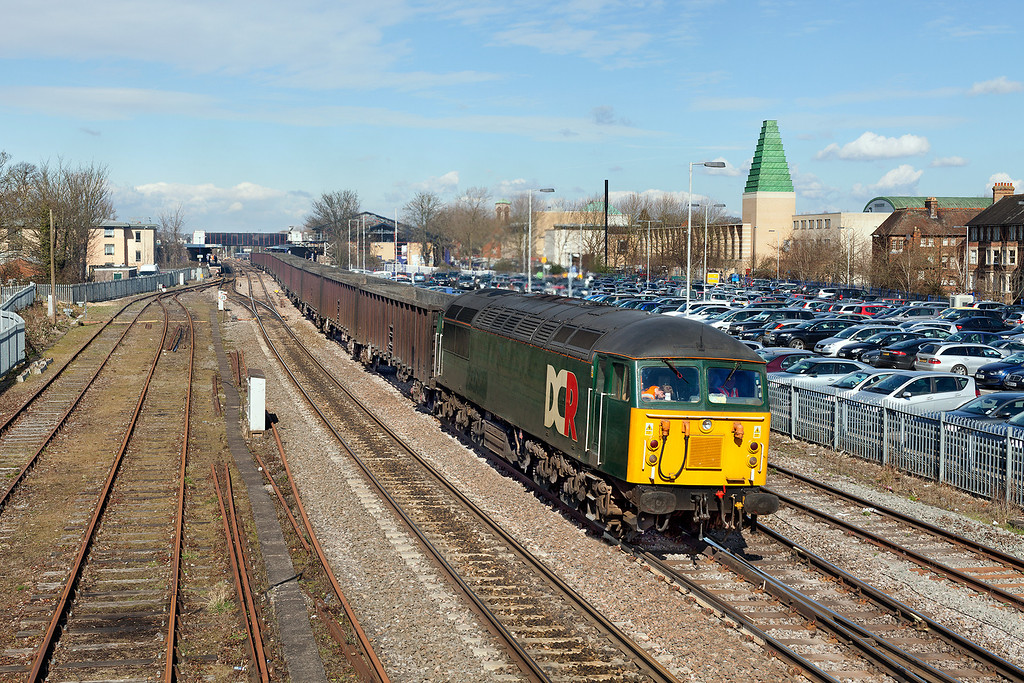 A combination of factors meant I ended up at Oxford station rather than Hinksey or Islip for the 6Z91 10.53 Calvert-Didcot Power station fly-ash empties hauled by 56303. <br /> DCR seem to be having a contest with WCRC to see who can apply the least photogenic livery to a loco. 14.3.13