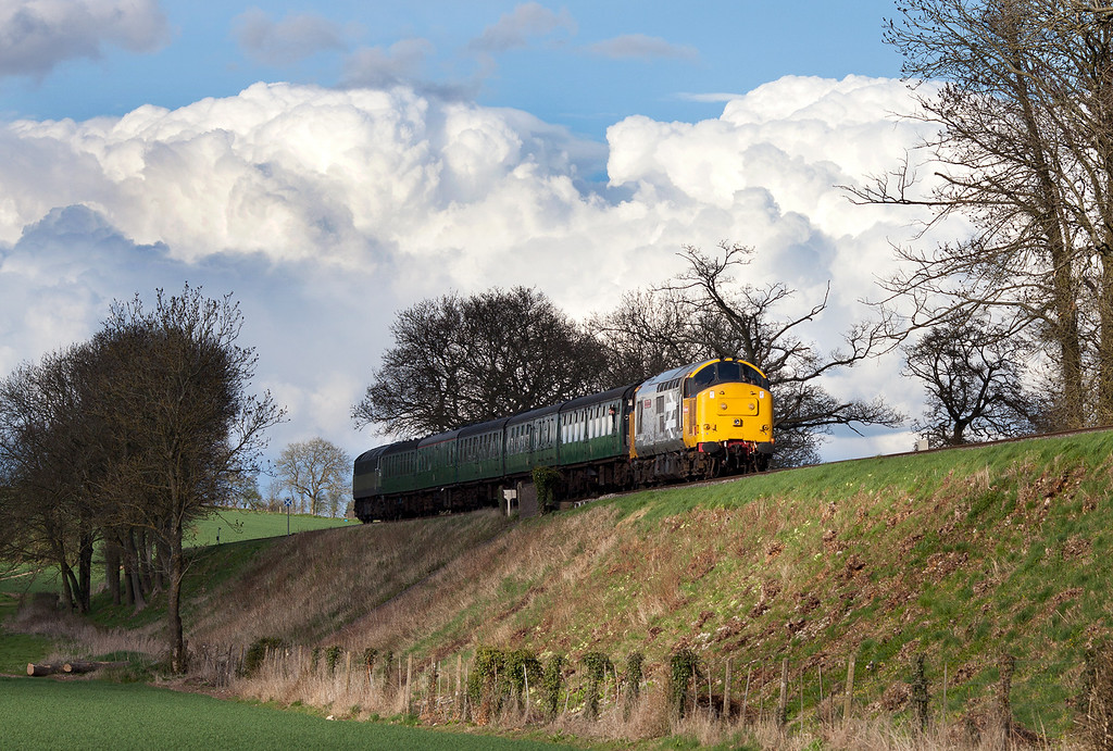 The clouds in the background probably give a clue to the type of weather we were experiencing during the 2013 Mid Hants Diesel Gala. 37901 races the shadows on the approach to Ropley with the 17.30 Alton-Alresford service.