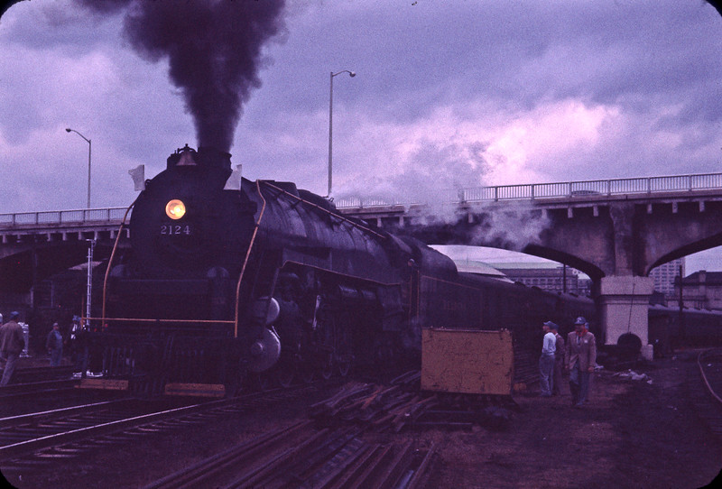 "Reading #2124, shown here on October 25, 1959, was known as ""Queen of the Iron Horse Rambles"".  The Iron Horse Rambles were steam powered excursions throughout the Reading system and these photographs depict the first of these post war excursions that lasted until 1964.  This particular excursion was on the Perkiomen branch running from near Phoenixville to Emmaus near Allentown, Pennsylvania."