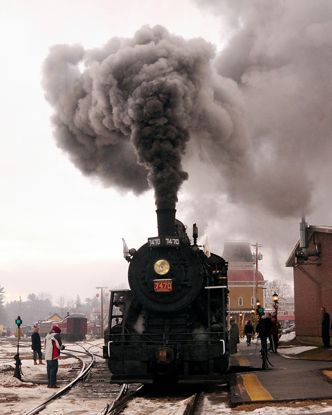 "The Conway Scenic Railroad's Steam Locomotive 7470 sits on the tracks, at the train station in North Conway, prior to the ""Steam In The Snow"" event, hosted by The Massachusetts Bay Railroad Enthusiasts, and the Conway Scenic Railroad, on January 2nd, 2011. The Mass Bay RRE, chartered an entire train, for a round-trip run from the North Conway train station, to The Notchland Inn, in Hart's Location. There were a number of photo stops along the way."